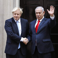 British Prime Minister Boris Johnson, left, welcomes Israel's Prime Minister Benjamin Netanyahu outside Downing Street in London, September 5, 2019. (AP Photo/Alastair Grant)
