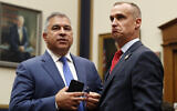 Corey Lewandowski, the former campaign manager for US President Donald Trump, stands with David Bossie, as he arrives to testify to the House Judiciary Committee, September 17, 2019, in Washington. (AP Photo/Jacquelyn Martin)