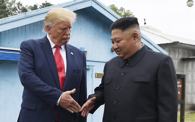 North Korean leader Kim Jong Un (right) and US President Donald Trump prepare to shake hands at the border village of Panmunjom in the Demilitarized Zone, South Korea, June 30, 2019. (AP Photo/Susan Walsh, File)