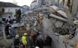 Rescuers try to free a man from a collapsed building, after a magnitude 6.4 earthquake in Thumane, western Albania, November 26, 2019. (AP Photo/Visar Kryeziu)