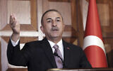 Turkey's Foreign Minister Mevlut Cavusoglu speaks to the media, in Ankara, Turkey, November 28, 2019. (AP Photo/Burhan Ozbilici)