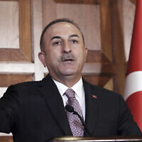 Turkey's Foreign Minister Mevlut Cavusoglu speaks to the media, in Ankara, Turkey, November 28, 2019. (AP Photo/Burhan Ozbilici)