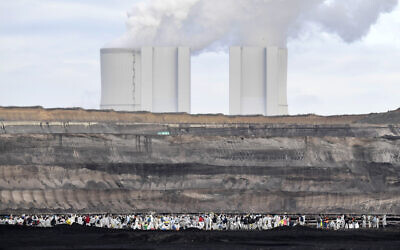 Supporters of the climate movement Ende Gelaende protest at the coal-fired power station Lippendorf near Leipzig, Germany, November 24, 2019. (Jens Meyer/AP)