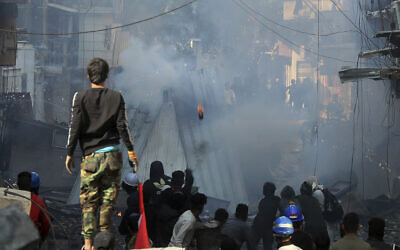 Riot police fire tear gas during clashes with anti-government demonstrators in Baghdad, Iraq, Saturday, Nov. 30, 2019. (AP/Hadi Mizban)