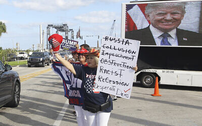 Supporters wait to see the motorcade carrying US President Donald Trump on his way to Mar-a-Largo in West Palm Beach, Fla., Sunday, Dec. 1, 2019. (AP Photo/Luis M. Alvarez)