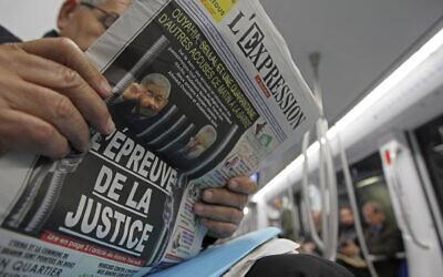 A man reads a newspaper headlining on the trial of two former Algerian prime ministers, Ahmed Ouyahia and Abdelmalek Sellal, in Algiers December 2, 2019. (Fateh Guidoum)