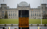 """This photo from December 2, 2019, shows an oversized urn placed by the artist group 'Center for Political Beauty"""" in front of German parliament building, the Reichstag, in Berlin, Germany. (Photo/Markus Schreiber)"""