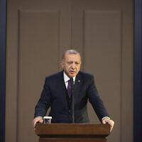 Turkey's President Recep Tayyip Erdogan speaks before departing to attend a NATO leader's summit in London, in Ankara, Turkey, December 3, 2019. (Presidential Press Service via AP, Pool)