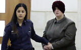 Malka Leifer, right, is brought to a courtroom in Jerusalem, February 27, 2018. (AP Photo/Mahmoud Illean, File)