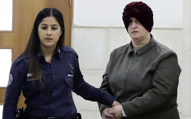 In this photo from February 27, 2018, Malka Leifer, right, is brought to a courtroom in Jerusalem. (AP Photo/Mahmoud Illean, File)