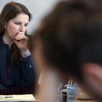 Sarah Moriarty, the daughter of Robert Levinson, a US hostage in Iran, listens during a news conference about hostages in Iran, December 3, 2019, in Washington. (AP Photo/Jacquelyn Martin)