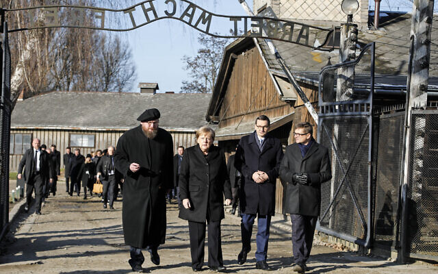 Museum director Piotr Cywinski, German Chancellor Angela Merkel, Polish Prime Minister Mateusz Morawiecki and deputy director Andrzej Kacorzyk, from left, visit the former Nazi death camp of Auschwitz-Birkenau in Oswiecim, Poland on Friday,  Dec. 6, 2019 (Photo/Markus Schreiber)