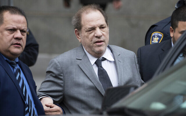 Harvey Weinstein, center, leaves court following a bail hearing on December 6, 2019 in New York. (AP Photo/Mark Lennihan)