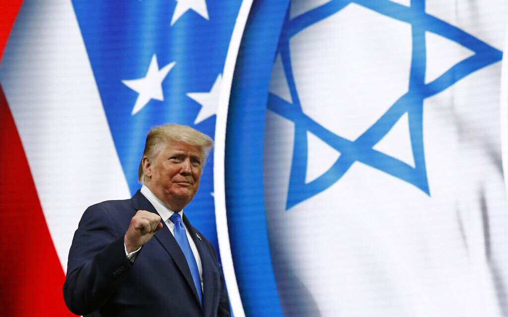 US President Donald Trump walks onstage to speak at the Israeli American Council National Summit in Hollywood, Florida, December 7, 2019. (Patrick Semansky/AP)