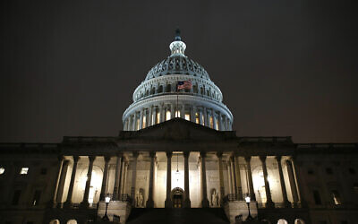 Lights shine on the U.S. Capitol dome, Monday, Dec. 9, 2019, after the House Judiciary Committee heard investigative findings in the impeachment inquiry of US President Donald Trump on Capitol Hill in Washington. (AP Photo/Patrick Semansky)