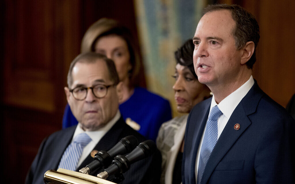 Democratic Representative Adam Schiff of California, chairman of the House Intelligence Committee, right, speaks with from left Chairman of the House Judiciary Committee Jerrold Nadler, a New York Democrat, House Speaker Nancy Pelosi and Chairwoman of the House Financial Services Committee Maxine Waters, a California Democrat, second from right, during a news conference to unveil articles of impeachment against President Donald Trump, abuse of power and obstruction of Congress, December 10, 2019, on Capitol Hill in Washington. (AP Photo/Andrew Harnik)