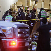 Emergency responders work at a kosher supermarket, the site of a shooting in Jersey City, N.J., Wednesday, December 11, 2019. (AP/Seth Wenig)
