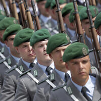 Soldiers attend an oath-taking ceremony of the German army at the Defence Ministry in Berlin, Germany, July 20, 2019. (AP Photo/Michael Sohn)