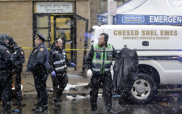 Emergency responders work near a kosher supermarket and a synagogue near the site of shooting in Jersey City, N.J., Wednesday, Dec. 11, 2019. (AP Photo/Seth Wenig)