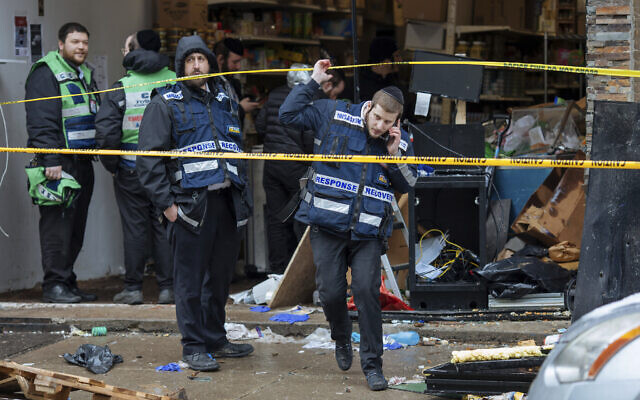 Responders work to clean up the scene of a shooting that left multiple people dead at a kosher market, December 11, 2019, in Jersey City, New Jersey. (AP Photo/Kevin Hagen)
