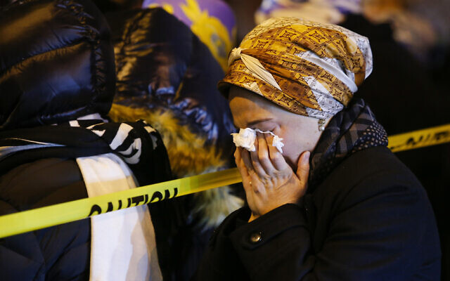 Orthodox Jewish women mourn during the funeral service of Mindel Ferencz, who was killed in a shooting at a kosher market in Jersey City, New Jersey, December 11, 2019. (AP Photo/Eduardo Munoz Alvarez)
