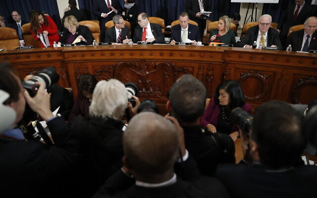 Members of the committee arrive before a House Judiciary Committee markup of the articles of impeachment against President Donald Trump, Thursday, Dec. 12, 2019, on Capitol Hill in Washington. (AP/Andrew Harnik)