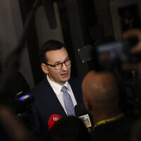 Polish Prime Minister Mateusz Morawiecki speaks with the media at the end of an EU summit in Brussels, December 13, 2019. (AP Photo/Francisco Seco)