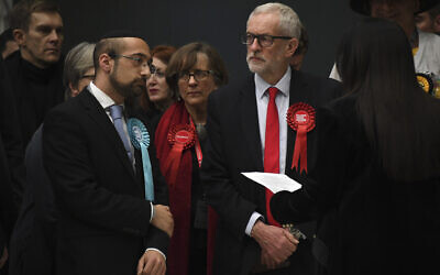 British opposition Labour Party leader Jeremy Corbyn, right, waits for the declaration of his seat in the 2019 general election in Islington, London, December 13, 2019 (AP Photo/Alberto Pezzali)