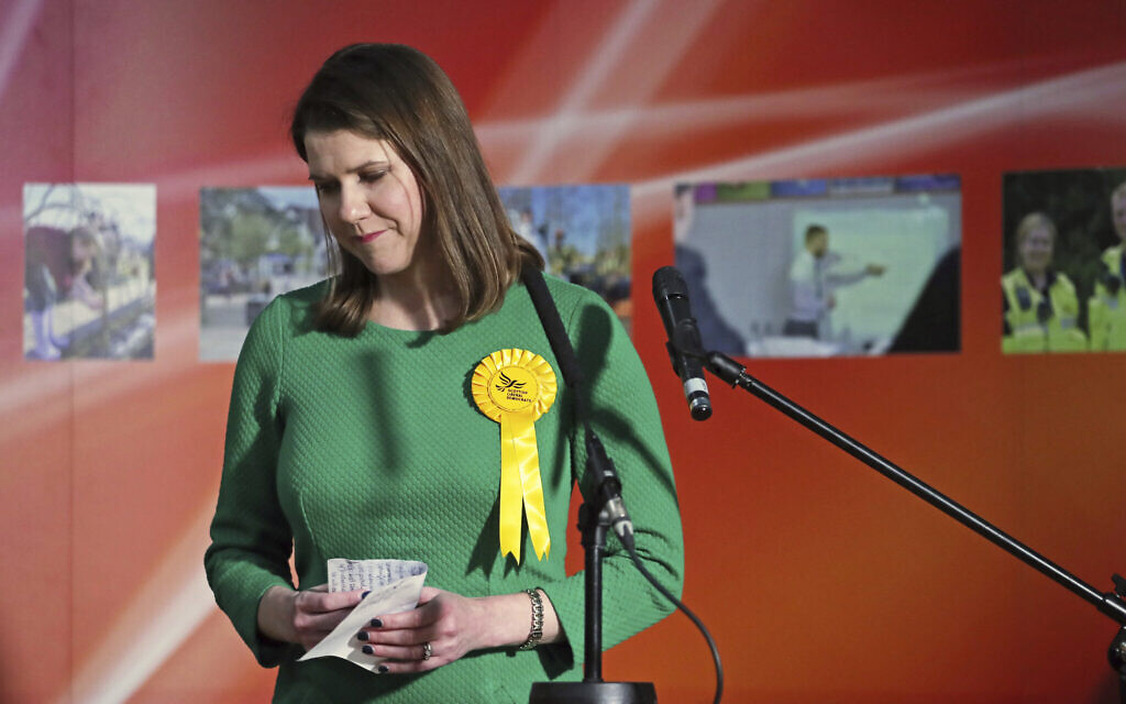 Lib Dem leader Jo Swinson, second right, reacts as she loses her East Dumbartonshire constituency, during the count at the Leisuredome, Bishopbriggs, Scotland, December 13, 2019.  (Jane Barlow/PA via AP)