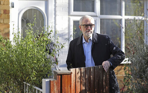 Leader of Britain's main opposition Labour Party, Jeremy Corbyn leaves his home in north London, Saturday Dec. 14, 2019. (Isabel Infantes/PA via AP)