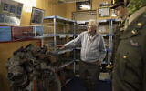 In this photo taken on November 7, 2019, Marcel Schmetz shows the motor of a crashed World War II Marauder B-26 at the Remember Museum 39-45 in Thimister-Clermont, Belgium. (AP Photo/Virginia Mayo)