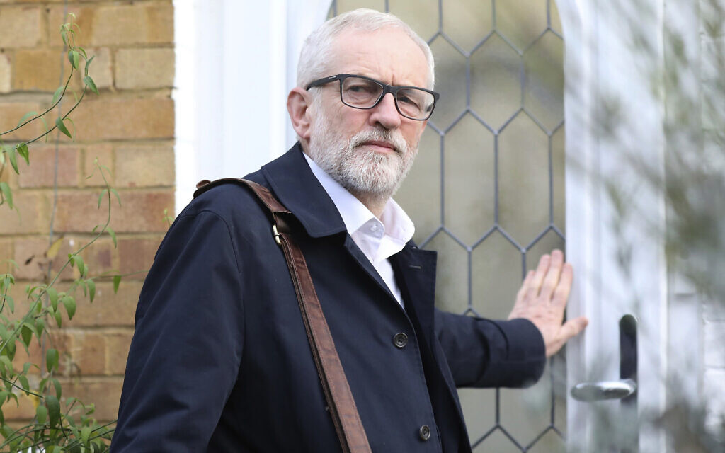 Labour Party leader Jeremy Corbyn leaves his home in Islington, north London, December 16, 2019. (Isabel Infantes/PA via AP)