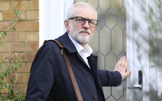 Then Labour Party leader Jeremy Corbyn leaves his home in Islington, north London, December 16, 2019. (Isabel Infantes/PA via AP)