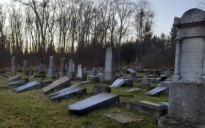 In this photo from December 16, 2019, dozens of damaged tombstones lay at the Jewish cemetery in Namestovo, Slovakia. (AP Photo/Karol Kurtulik)