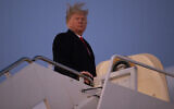 US President Donald Trump boards Air Force One for a campaign rally in Battle Creak, Mich., Wednesday, Dec. 18, 2019, in Andrews Air Force Base, Md. (AP Photo/ Evan Vucci)