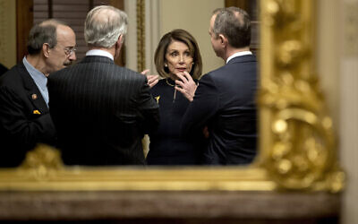 House Speaker Nancy Pelosi of California, center, speaks with other Democrat lawmakers in a private room just off the House floor after the House voted to impeach US President Donald Trump, on Capitol Hill in Washington, December 18, 2019. (Andrew Harnik/AP)