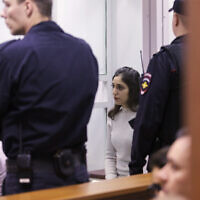 US-Israeli backpacker Naama Issachar, center, sits inside a glass cage during appeal hearings in a courtroom in Moscow, Russia, December 19, 2019. (Alexander Zemlianichenko Jr./AP)