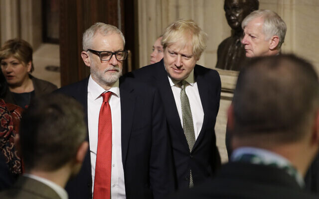 Britain's Prime Minister Boris Johnson (center right) and opposition Labour Party Leader Jeremy Corbyn walk through the Commons Members Lobby during the state opening of Parliament, in London, December 19, 2019. (AP Photo/Kirsty Wigglesworth, Pool)