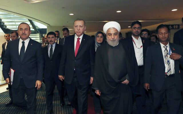 Turkey's President Recep Tayyip Erdogan center left, walks with Iran's President Hassan Rouhani, centre right, following their meeting at the sidelines of the Kuala Lumpur Summit in Kuala Lumpur, Malaysia on December 19, 2019. (Presidential Press Service via AP, Pool)