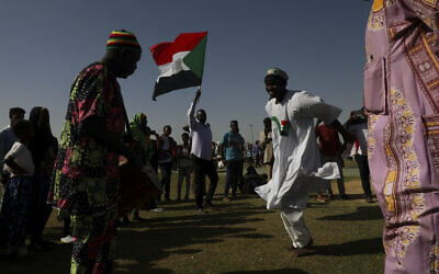 People gather as they celebrate the first anniversary of mass protests that led to the ouster of former president and longtime autocrat Omar al-Bashir in Khartoum, Sudan, November 19, 2019. (AP Photo)