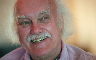 In an October 21, 1998, file photo, Ram Dass, best known for the 1971 bestseller 'Be Here Now,' smiles during an interview at his San Anselmo, California, home (AP Photo/Susan Ragan, File)