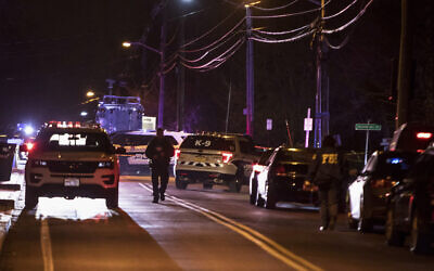 Authorities gather on a street in Monsey, New York, Sunday, December 29, 2019, following a stabbing rampage late Saturday during a Hanukkah celebration. (AP/Allyse Pulliam)