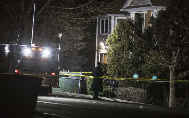 An Orthodox Jewish man stands in front of a residence in Monsey, N.Y., Sunday, Dec. 29, 2019, following a stabbing spree late Saturday during a Hanukkah celebration. (AP/Allyse Pulliam)