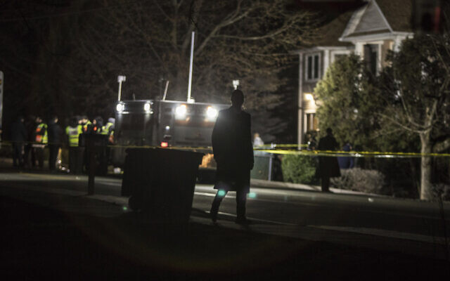 Authorities and first responders gather in front of a residence in Monsey, New York, Sunday, December 29, 2019, following a stabbing spree late Saturday during a Hanukkah celebration in a rabbi's home. (AP Photo/Allyse Pulliam)
