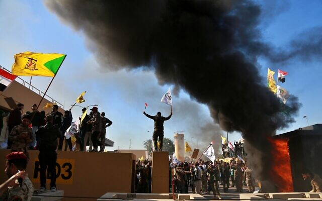 Protesters burn property in front of the US embassy compound, in Baghdad, Iraq, Dec. 31, 2019. (Khalid Mohammed/AP)