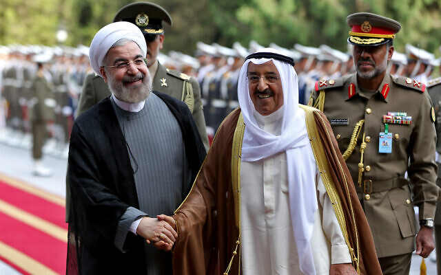 Kuwait's emir Sheik Sabah Al Ahmed Al Sabah, right, shakes hands with Iranian President Hassan Rouhani, left, during an official reception ceremony at the Saadabad Palace in Tehran, Iran, June 1, 2014. (AP Photo/Ebrahim Noroozi)