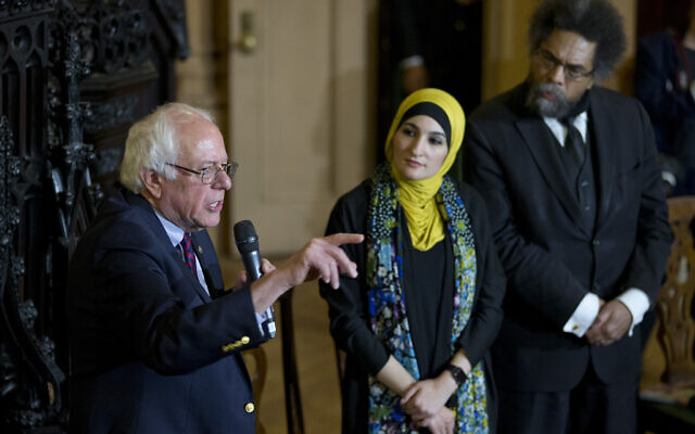 Linda Sarsour, center and Cornel West, right, listen as Democratic presidential candidate Bernie Sanders, I-Vt., speaks in a roundtable discussion at the First Unitarian Congregational Society, Saturday, April 16, 2016, in the Brooklyn borough of New York. (AP Photo/Mary Altaffer)