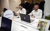 Ultra-Orthodox Jewish men work at a high tech start-up in an office in Tel Aviv, on March 15, 2016.  (AP Photo/Dan BaliltyFile)