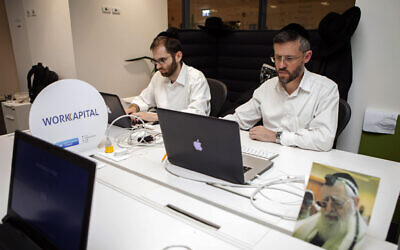 Ultra-Orthodox Jewish men work at a high tech start-up in an office in Tel Aviv, on March 15, 2016.  (AP Photo/Dan BaliltyFile)