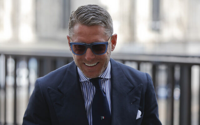 Lapo Elkann smiles to photographers as he arrives to attend a lunch in Milan, Italy, February 24, 2016. (AP Photo/Luca Bruno)